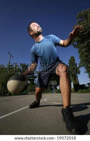 man play basketball - stock photo