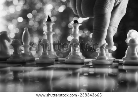 Man play chess. Close up of chess game. - stock photo
