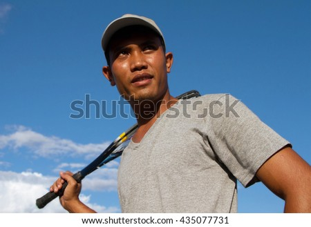 Man player tennis With sky sunny - Sport Concept - stock photo