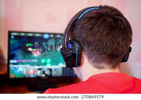 Man playing a computer games - stock photo