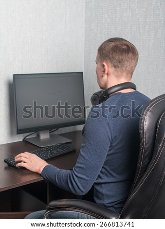 Man playing a computer games at home - stock photo