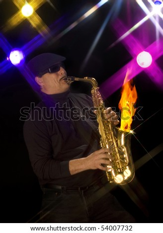 Man playing a flaming saxophone with stage lights in the background
