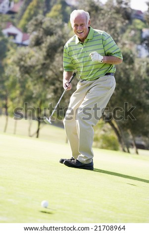 Man Playing A Game Of Golf - stock photo