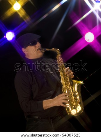 Man playing a saxophone with stage lights in the background