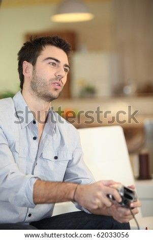 Man playing a video game - stock photo