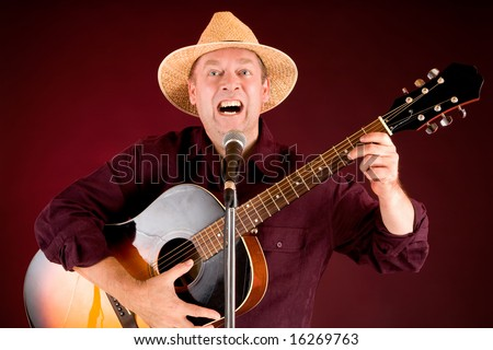 Man Playing Acoustic Guitar and Singing - stock photo