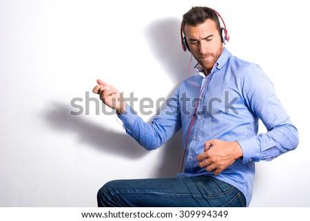 Man playing air guitar - stock photo