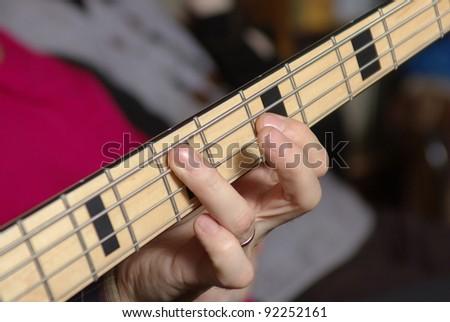 Man playing an bass guitar - stock photo
