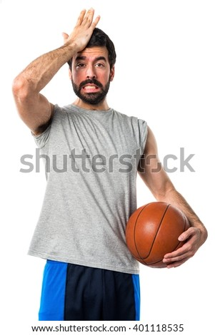Man playing basketball doing surprise gesture