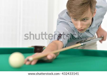 man playing billiards in  billiard club - stock photo