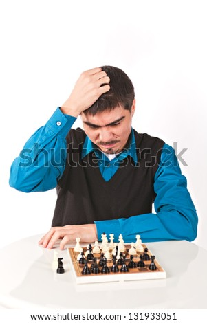 Man playing chess thinking about next step on white background