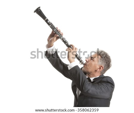 man playing clarinet Mature man playing clarinet on white studio backround