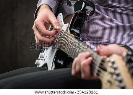 Man playing electric guitar - stock photo
