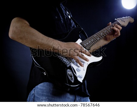 Man playing electrical guitar - stock photo