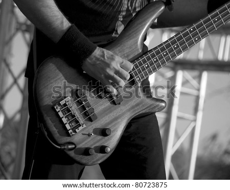 Man playing electrical guitar in black and white - stock photo