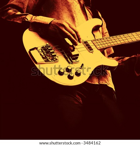 man playing electrical guitar in black and yellow - stock photo