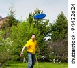 Man playing frisbee at his backyard - stock photo