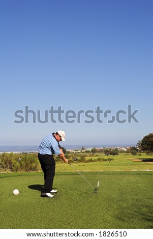 Man playing golf.