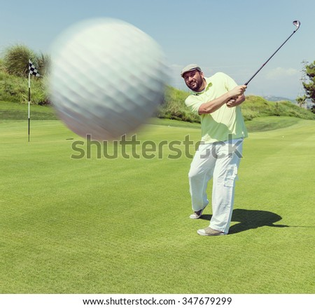 Man playing golf at club - stock photo