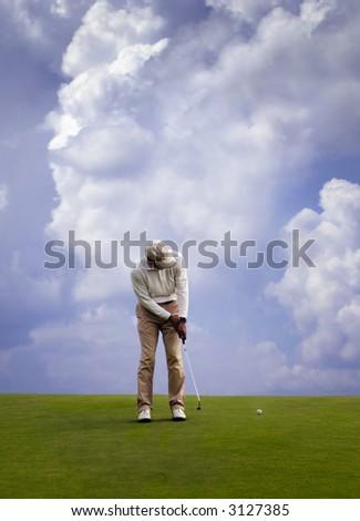 Man playing golf. *web use* - stock photo