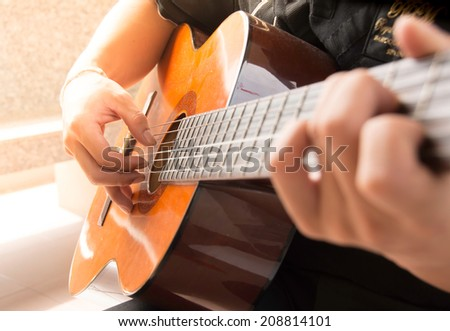 Man playing  guitar  - stock photo