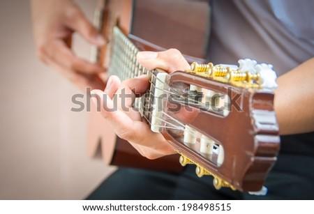 Man playing guitar , close up - stock photo