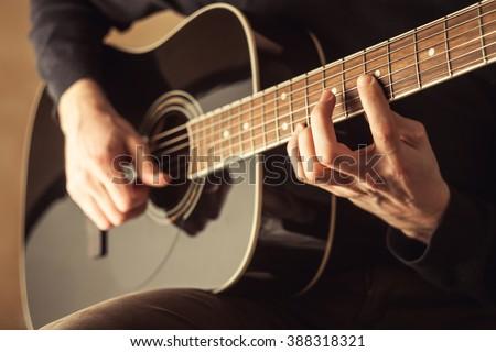 man playing guitar, guitar close-up shot, acoustic guitar, guitar playing, 6th string guitar - stock photo