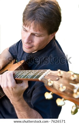 man playing guitar, overhead view, isolated over white - stock photo