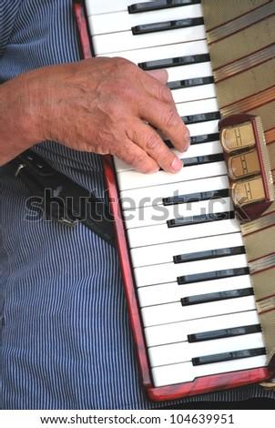man playing her accordion - stock photo