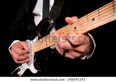 Man playing his guitar. Shoot in low key technique  - stock photo