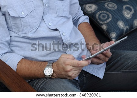 Man playing on a tablet