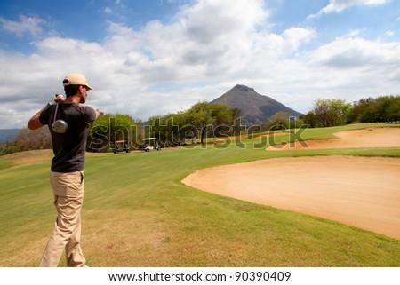 Man playing on green - stock photo