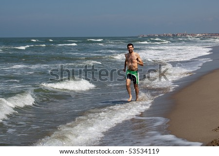 man playing on the beach