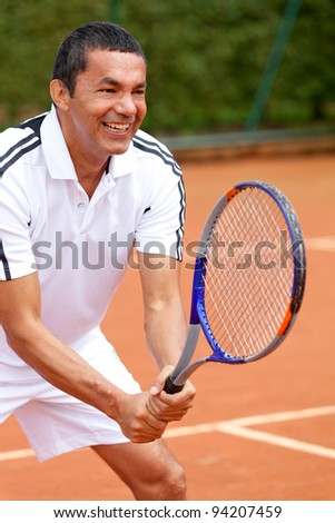 Man playing tennis and waiting for the service - stock photo