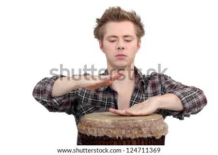 Man playing the bongos - stock photo