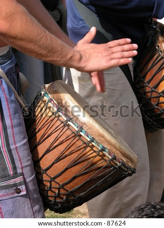 Man playing the djembe (nigerian drum) - stock photo