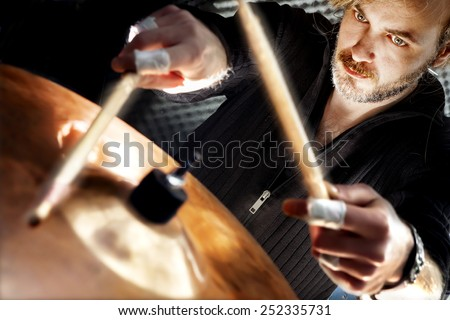 Man playing the drum.Live music background concept.Drummer and rock music - stock photo