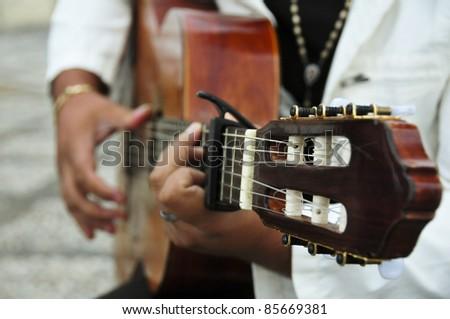 Man playing the Spanish guitar - stock photo