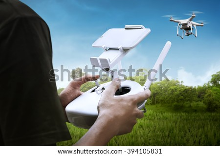 Man playing with drone with blue sky background