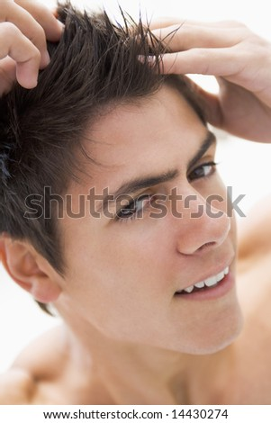 Man playing with hair smiling - stock photo