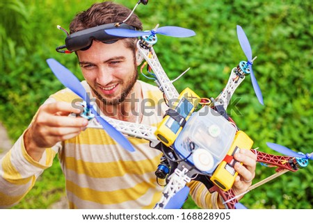 man playing with his copter