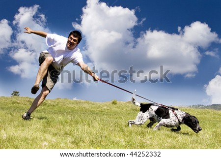 Man playing with his dog on sunny summer day - stock photo