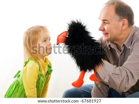 Man playing with little girl - stock photo