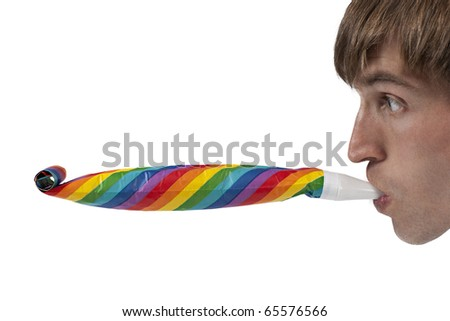 Man playing with party blowers - stock photo