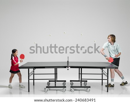 Man Playing Young Girl in Ping Pong - stock photo