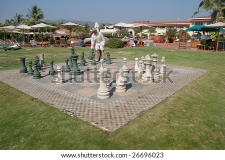 man plays a chess in hotel Goa - stock photo
