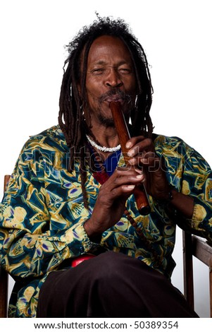 Man plays a traditional wooden flute, studio image - stock photo