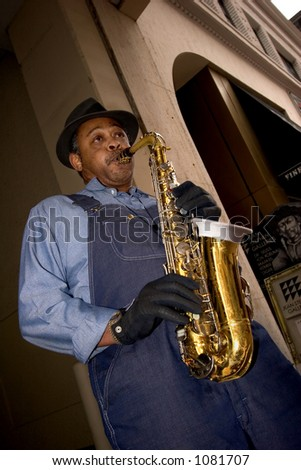 Man plays the saxophone in downtown Minneapolis - stock photo