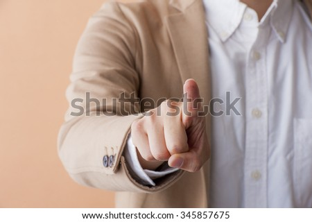 Man pointing a finger - stock photo