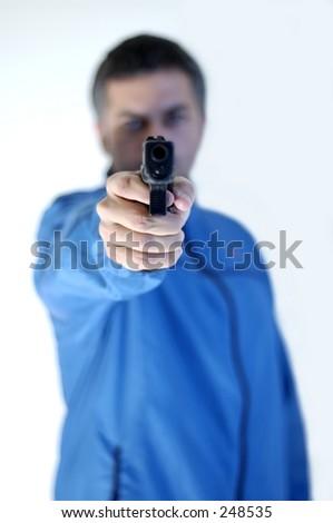 Man pointing a gun. - stock photo